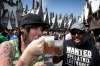 "Visitors drink ""butterbeer"", a beverage featured in the ""Harry Potter"" books and movies, during the grand opening of The ..."