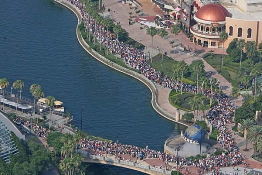 Thousands of people line up for the grand opening of the Wizarding World of Harry Potter at Universal's Islands of ...