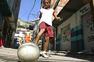 Rio favela. Eleven-year-old Victor Soares plays football