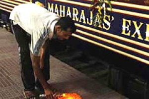Goodbye and good luck ... a railway worker lights an earthenware candle in preparation for the departure of the ...