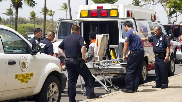 A 16-year-old boy who stowed away on a flight from California to Hawaii is loaded into an ambulance.