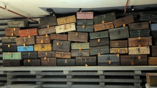 A wall of Indian luggage trunks make a striking feature at HotelHotel