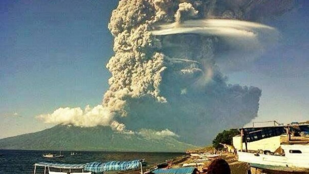 Ash spews from the Sangeang Api volcano off the north-east coast of the Indonesian island of Sumbawa.