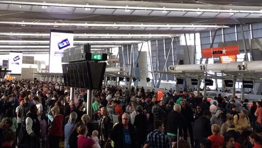 Large crowds at Sydney airport after a power outage at T2 terminal.