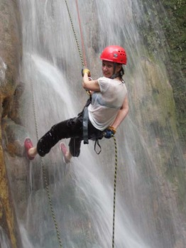 The writer abseils down Mele Cascades Waterfall.