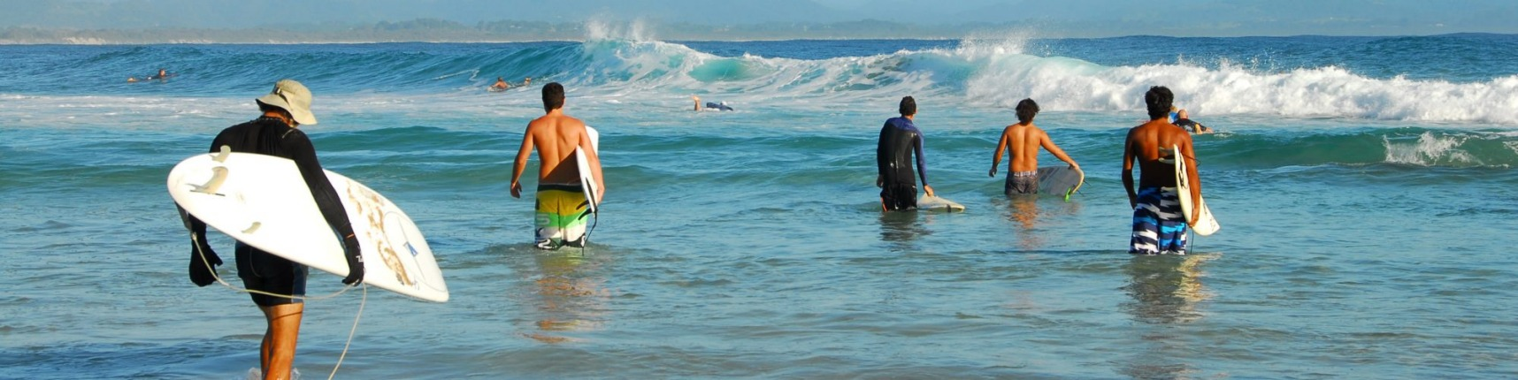 Surfers at Byron Bay.